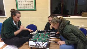 Enjoying a game of table football
